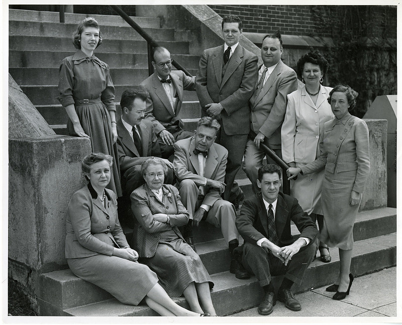 Front row (left to right): Cornelia V. Christenson; Mrs. Leser; Clyde E. Martin. Arranged on steps (