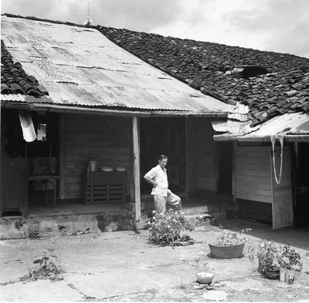 Watson M. Perrygo standing a patio in Soná, Veraguas, Panama, 1953
