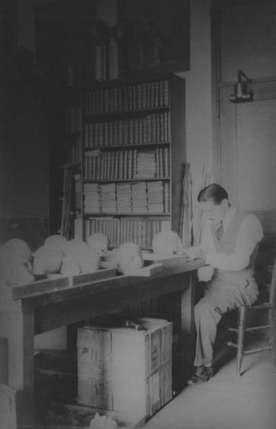 Henry B. Collins, Jr. with Skull Collection
