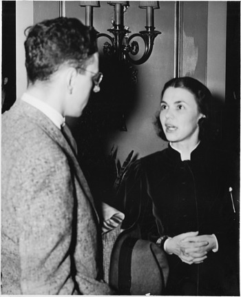 left to right: Unidentified man and Marion Schmidt Escallon (1912-2003)