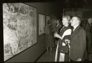 "Visitors View the World Map of Martin Walkdseemuller at ""The Naming of America"""
