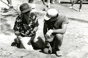 Curator Doug Owsley and Archaeological Dig Team Member Examine Bone at Antietam