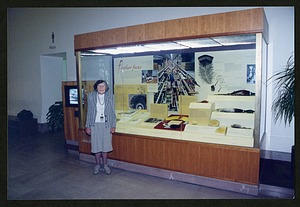 """Roxie Laybourne standing in front of the """"Feather Focus"""" Exhibit Case"""