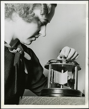 Dr. Ruby Worner operates a crease meter in a textile laboratory at the U.S. National Bureau of Standards