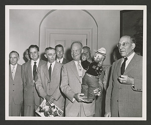 President Dwight Eisenhower holding a Smokey Bear doll