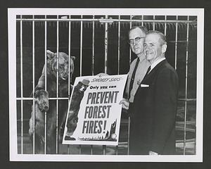 Senator Frank E. Moss and U.S. Forest Service Assistant Chief Edward P. Cliff, with Smokey Bear